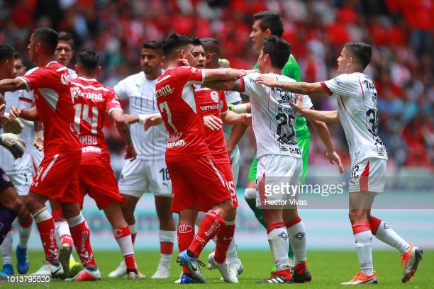 Players of Toluca and Chivas fight during the third round match between Toluca and Chivas as part of the Torneo Apertura 2018 Liga MX at Nemesio Diez...