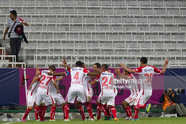 Players of Toluca celebrate after scoring their second goal during a match between Atlas and Toluca as part of 13th round Apertura 2014 Liga MX at...