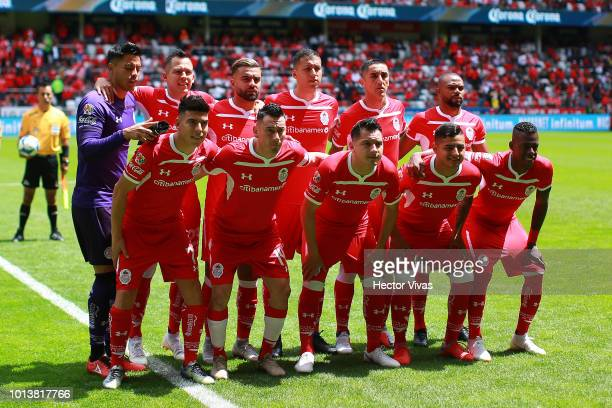 Players of Toluca pose prior the third round match between Toluca and Chivas as part of the Torneo Apertura 2018 Liga MX at Nemesio Diez Stadium on...
