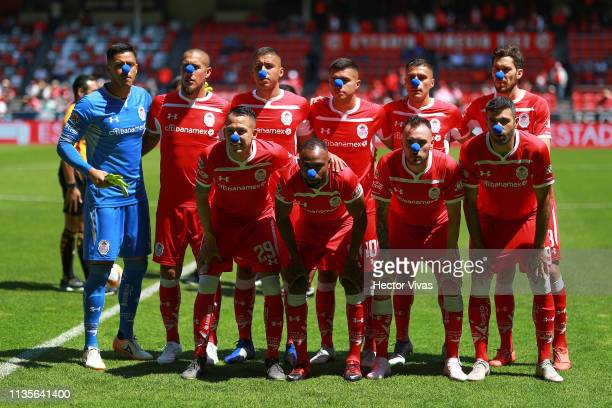 Players of Toluca wear a blue nose to create awareness over autism prior the 13th round match between Toluca and Monterrey as part of the Torneo...