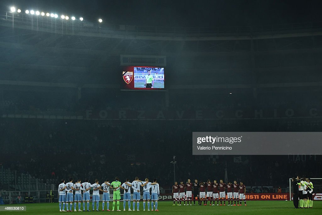 Players of Torino FC and SS Lazio stand for a minutes silence for referee Luca Colosimo prior to the Serie A match between Torino FC and SS Lazio at Stadio Olimpico di Torino on March 16, 2015 in Turin, Italy.