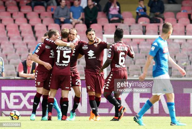 Players of Torino FC celebrate after the 22 goal scored by Lorenzo De Silvestri beside the disappointment of Adam Ounas of SSC Napoli during the...
