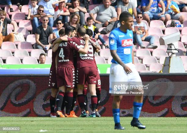 Players of Torino FC celebrate the 11 goal scored by Daniele Baselli beside the disappointment of Allan of SSC Napoli during the serie A match...