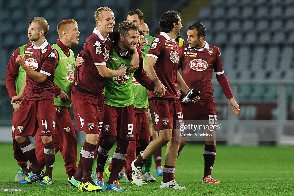 Players of Torino FC celebrate victory at the end of the Serie A match between Torino FC and Calcio Catania at Stadio Olimpico di Torino on November 24, 2013 in Turin, Italy.