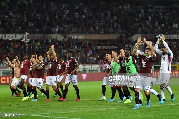 Players of Torino FC celebrate victory at the end of the UEFA Europa League Third Qualifying Round First Leg fixture between Torino FC and FC...
