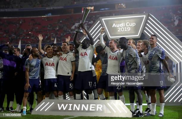 Players of Tottenham Hotspur lift the trophy after winning the Audi cup 2019 final match between Tottenham Hotspur and Bayern Muenchen at Allianz...