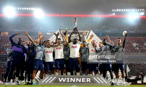 Players of Tottenham Hotspur lift the trophy after winning the Audi cup 2019 final match between Tottenham Hotspur and Bayern Muenchen at Allianz...