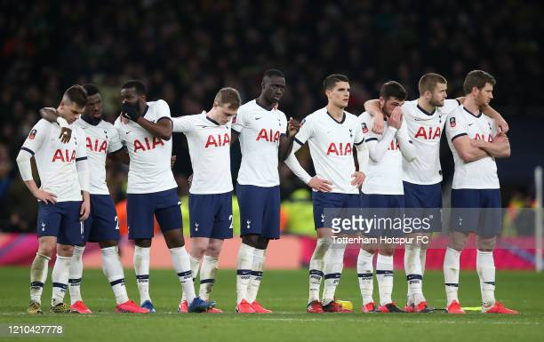 Players of Tottenham Hotspur look on in the penalty shootout during the FA Cup Fifth Round match between Tottenham Hotspur and Norwich City at...