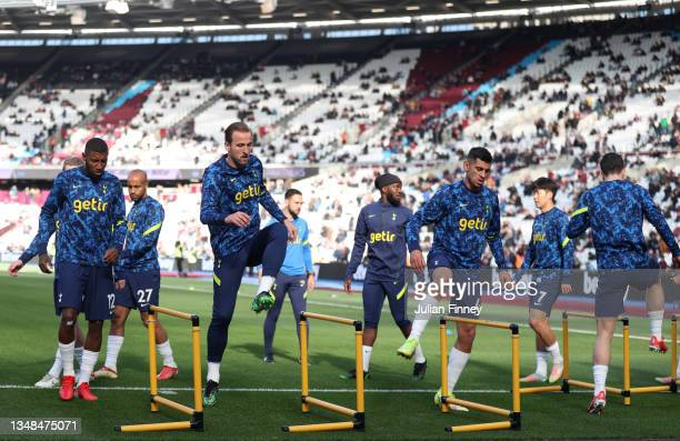 Players of Tottenham Hotspur warm up prior to the Premier League match between West Ham United and Tottenham Hotspur at London Stadium on October 24,...