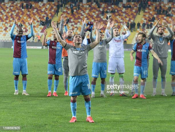 Players of Trabzonspor celebrate their victory at the end of the Turkish Super Lig postponed week 19 soccer match between Yeni Malatyaspor and...