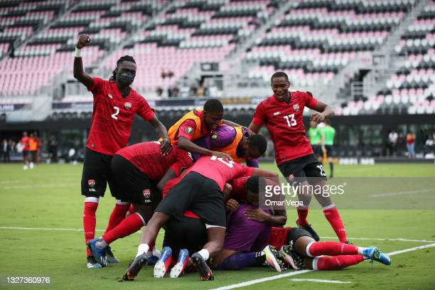 Players of Trinidad & Tobago celebrates after wining in penalties during the game between Trinidad & Tobago and French Guiana as part of CONCACAF...