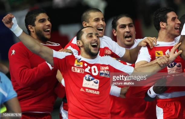 Players of Tunisia celebrate after the men's Handball World Championships main round match Argentina vs Tunisia in Barcelona Spain 18 January 2013...