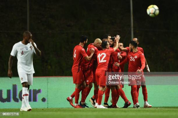 Players of Tunisia celebrates the draw goal during the international friendly football match against Portugal and Tunisia at the Municipal stadium de...