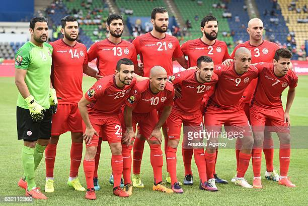 Players of Tunisia pose for a photo ahead of the African Cup of Nations Group B soccer match between Algeria and Tunisia at the Stade de Franceville...