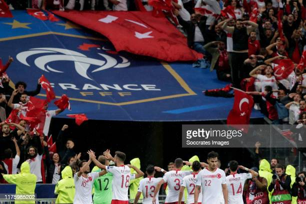 Players of Turkey celebrate the 1-1 with a military salute during the EURO Qualifier match between France v Turkey at the Stade de France on October...