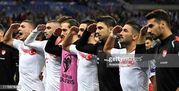 Players of Turkey make a formal salute after the UEFA EURO 2020 qualifier Group H soccer match between France and Turkey at Stade de France in...