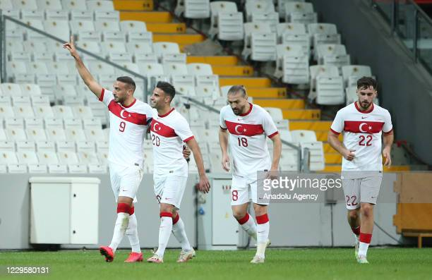 Players of Turkey National Football Team celebrate after Cenk Tosun scores a goal during a friendly match between the national football teams of...