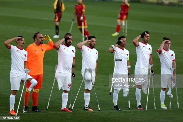 Players of Turkey salute as a celebration after scoring during the European Amputee Football Federation European Championship match between Turkey...