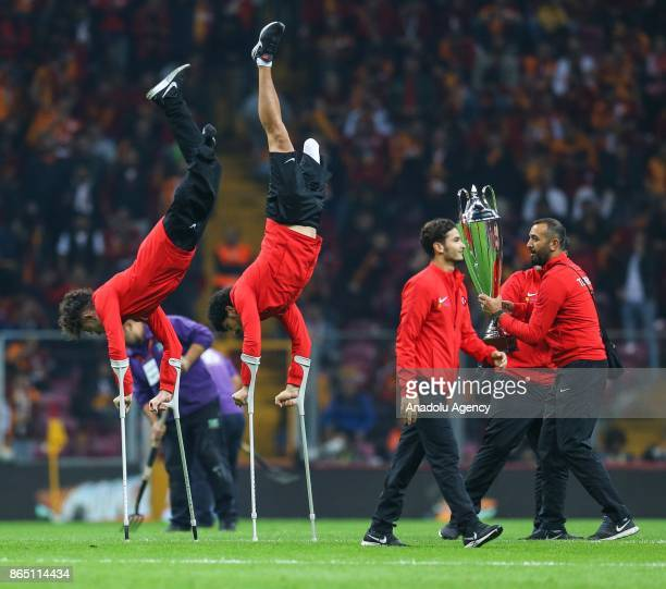 Players of Turkish Amputee National Football Team greet the supporters ahead of a Turkish Super Lig match between Galatasaray and Fenerbahce at Ali...