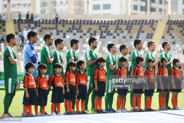 Players of Turkmenistan line up for team photos prior to during the AFC Asian Cup Group F match between Japan and Turkmenistan at Al Nahyan Stadium...