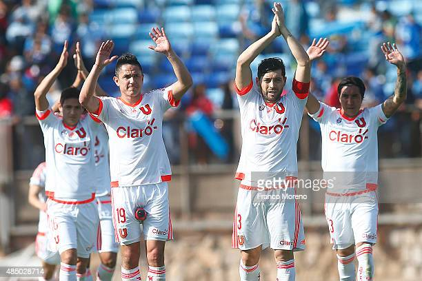 Players of U de Chile clap their hands after winning a match between San Marcos de Arica and U de Chile as part of fourth round of Torneo Apertura...
