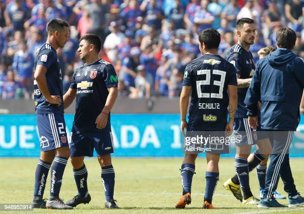 Players of U de Chile look dejected as they leave the field after a match between U de Chile and Colo Colo as part of Torneo Scotiabank 2018 at...