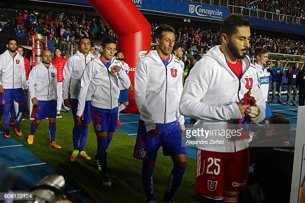 Players of U de Chile walk onto the field during a final match between U Catolica and U de Chile as part of Supercopa 2016 at Alcaldesa Ester Roa de...
