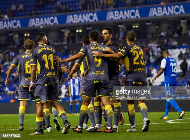 Players of UD Las Palmas celebrate the fourth goal during the Copa del Rey first leg match between Deportivo de La Coruna and UD Las Palmas at Riazor...