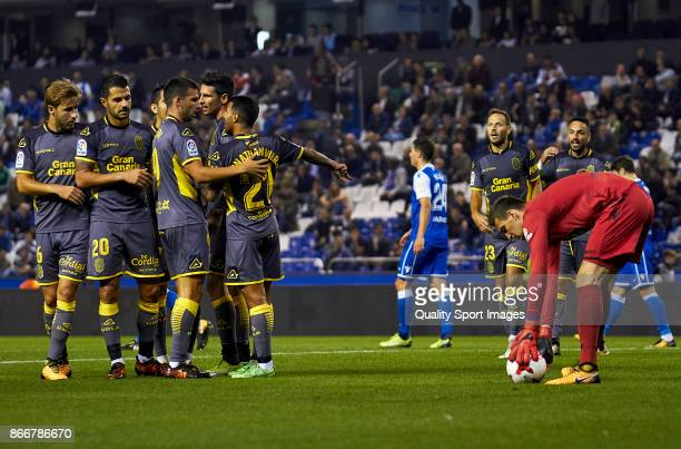 Players of UD Las Palmas celebrate the third goal during the Copa del Rey first leg match between Deportivo de La Coruna and UD Las Palmas at Riazor...