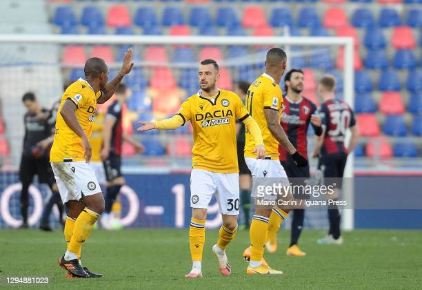 Players of Udinese Calcio celebrate after the goal scored by Roberto Pereyra of Udinese Calcio during the Serie A match between Bologna FC and...