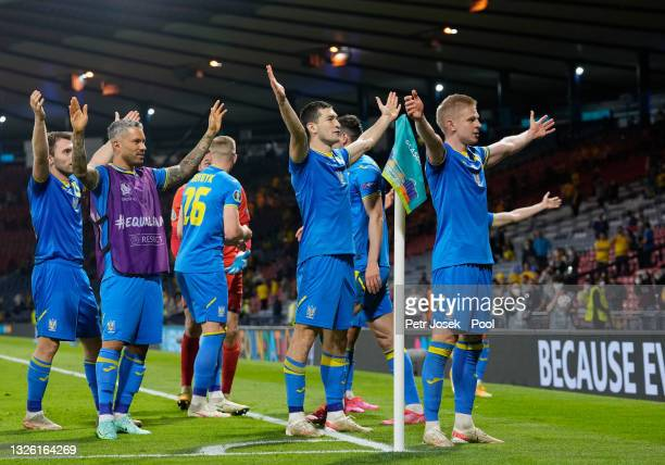 Players of Ukraine celebrate after victory in the UEFA Euro 2020 Championship Round of 16 match between Sweden and Ukraine at Hampden Park on June...