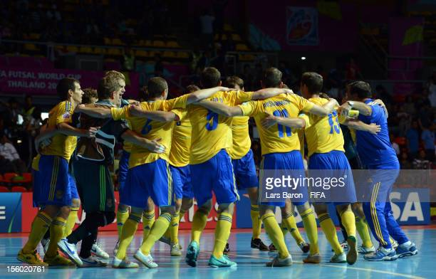 Players of Ukraine celebrate after winning the FIFA Futsal World Cup Round of 16 match between Ukraine and Japan at Indoor Stadium Huamark on...