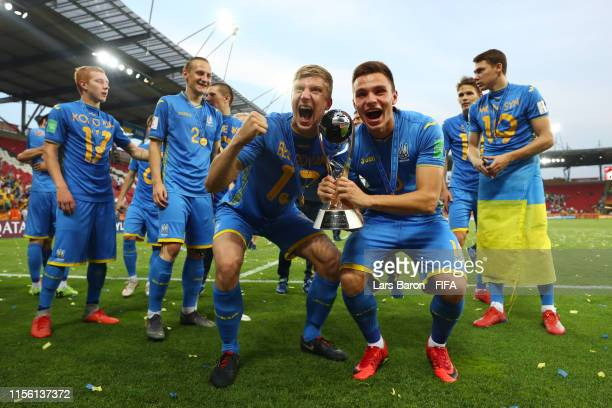 Players of Ukraine celebrate with the FIFA U-20 World Cup trophy following their victory in the 2019 FIFA U-20 World Cup Final between Ukraine and...