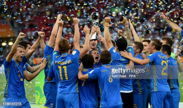 Players of Ukraine celebrate with the trophy after winning the 2019 FIFA U20 World Cup Final between Ukraine and Korea Republic at Lodz Stadium on...