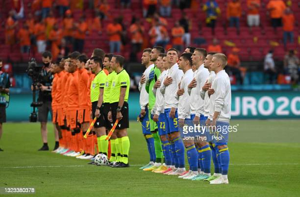 Players of Ukraine sing the national anthem prior to the UEFA Euro 2020 Championship Group C match between Netherlands and Ukraine at the Johan...