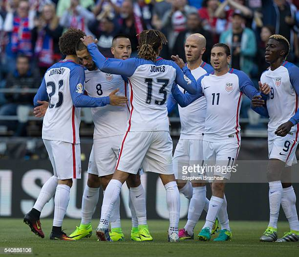 Players of United States celebrate their team's first goal during a Quarterfinal match between USA and Ecuador at CenturyLink Field as part of Copa...