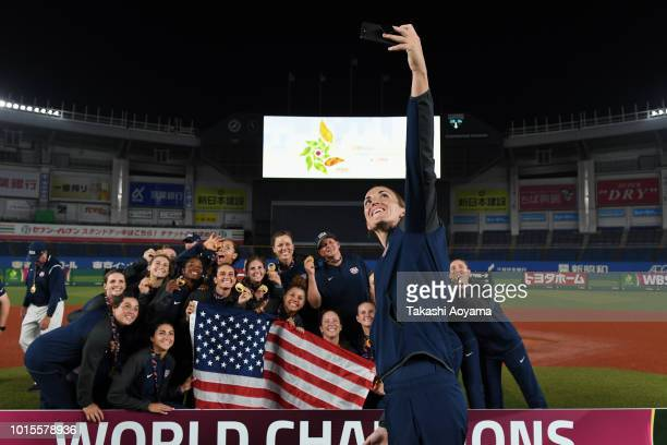 Players of United States celebrate with their gold medal and trophy after the awards ceremony at ZOZO Marine Stadium on day eleven of the WBSC...