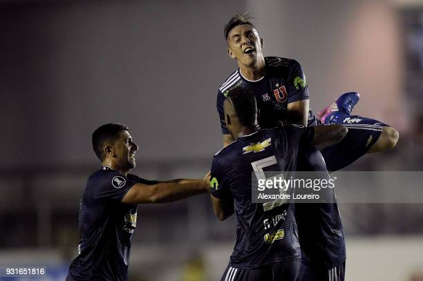 Players of Universidad de Chile celebrates their first scored goal by Angelo Araos during a Group Stage match between Vasco and Universidad de Chile...