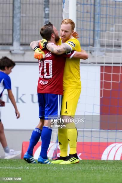 Players of Unterhaching celebrate after winning the 3 Liga match between KFC Uerdingen 05 and SpVgg Unterhaching at GrotenburgStadion on July 29 2018...