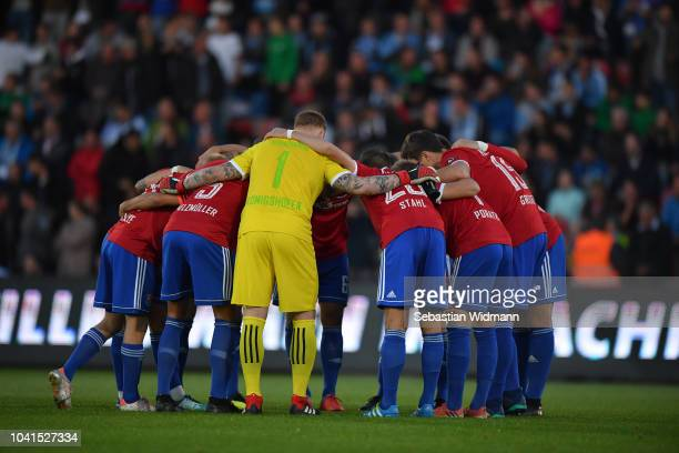 Players of Unterhaching form a circle prior to the 3 Liga match between SpVgg Unterhaching and TSV 1860 Muenchen at Alpenbauer Sportpark on September...