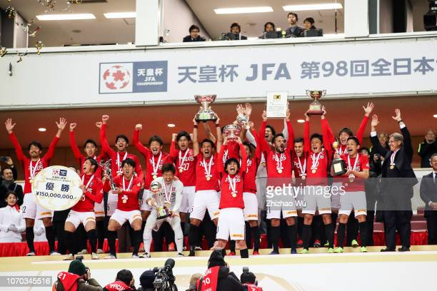 Players of Urawa Red Diamonds attend the award cemerony after the 98th Emperor's Cup Final between Urawa Red Diamonds and Vegalta Sendai at Saitama...