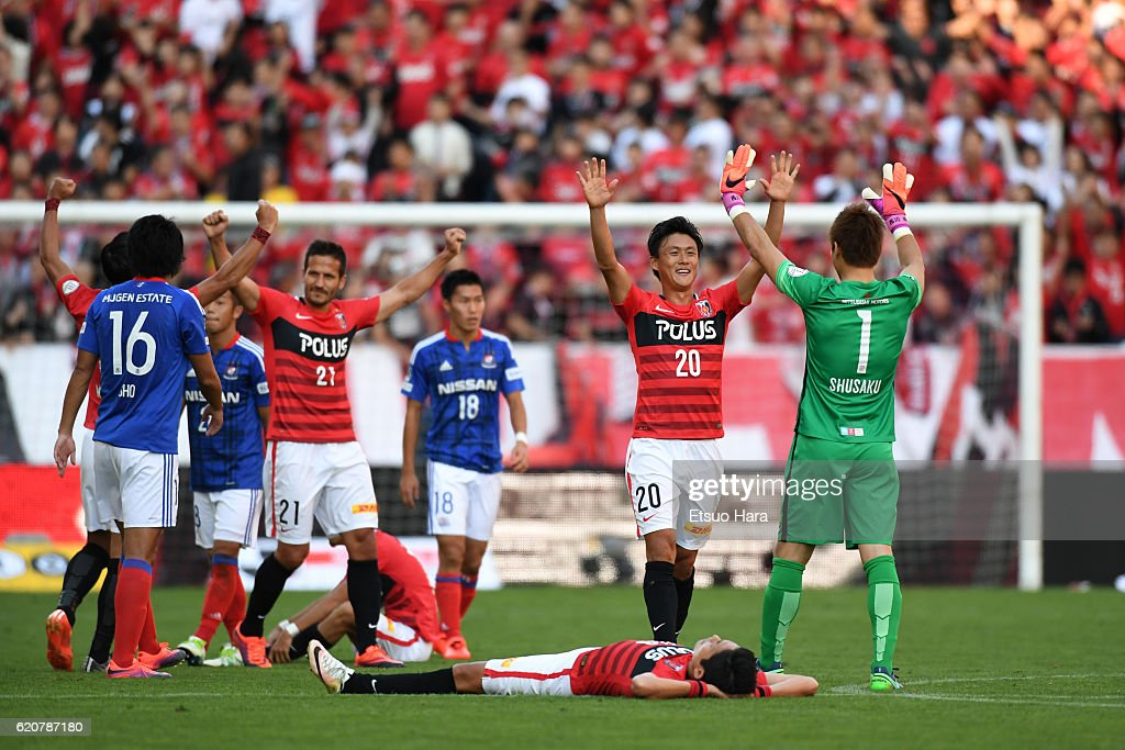 Players of Urawa Red Diamonds celebrate keeping their first place throughout the season after the J.League match between Urawa Red Diamonds and Yokohama F.Marinos at Saitama Stadium on November 3, 2016 in Saitama, Japan.