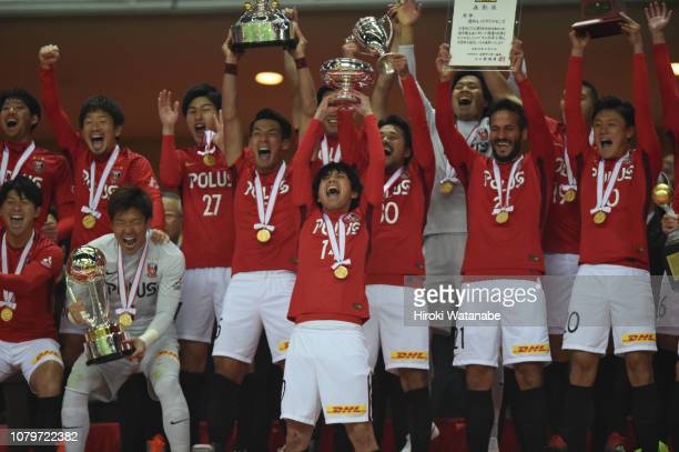 Players of Urawa Red Diamonds celebrate with the trophy after the 98th Emperor's Cup Final between Urawa Red Diamonds and Vegalta Sendai at Saitama...