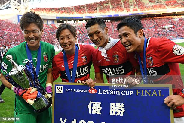 Players of Urawa Red Diamonds celebrate with the trophy after the J.League Levain Cup Final match between Gamba Osaka and Urawa Red Diamonds at the...