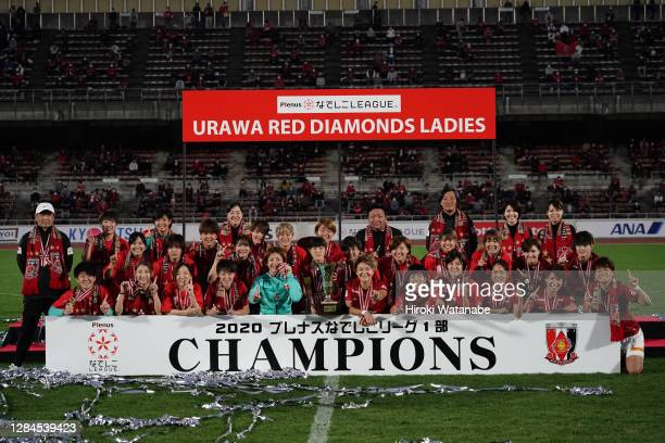 Players of Urawa Red Diamonds Ladies celebrate with the trophy after the Nadeshiko League match between Urawa Red Diamonds Ladies and Ehime FC Ladies...