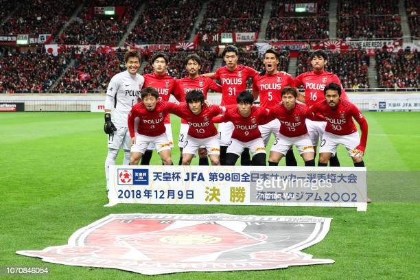 Players of Urawa Red Diamonds line up for team photos prior to the 98th Emperor's Cup Final between Urawa Red Diamonds and Vegalta Sendai at Saitama...