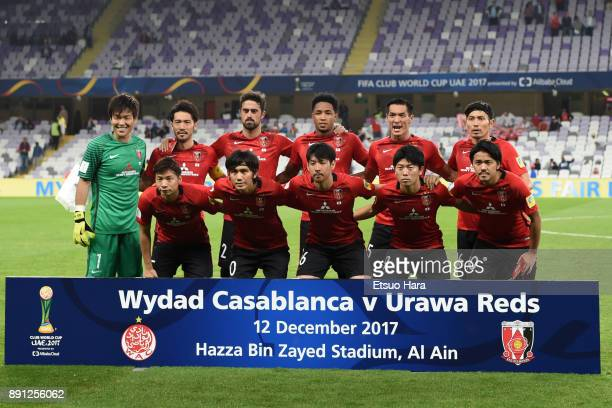 Players of Urawa Red Diamonds line up for the team photos prior to the FIFA Club World Cup UAE 2017 Match for 5th Place between Wydad Casablanca and...