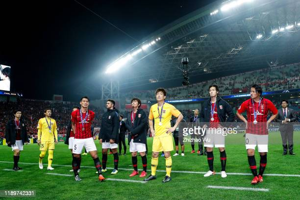 Players of Urawa Red Diamonds show their dejection after the AFC Champions League Final second leg match between Urawa Red Diamonds and Al Hilal at...