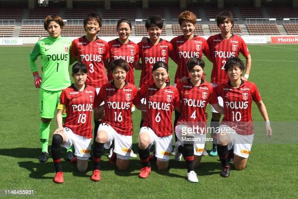 Players of Urawa Reds Ladies pose for photographs prior to the Nadeshiko League Division 1 match between Urawa Red Diamonds Ladies and INAC Kobe...