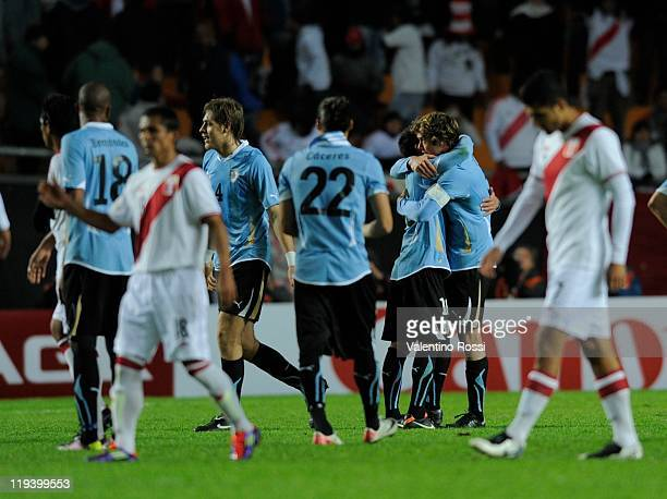Players of Uruguay celebrate at the end against Peru during 2011 Copa America soccer match as part of semifinal at the Ciudad de La Plata stadium on...